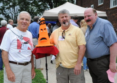 Tommy Curtain, Chris Donahoe & Bob Hamill pose at the museum