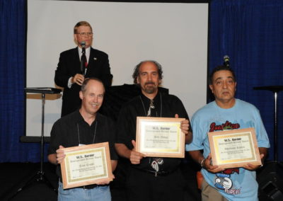 Mark Wade presents the WS Berger awards to Tom Crowl, Bob Abdou and Alfonso Rivera
