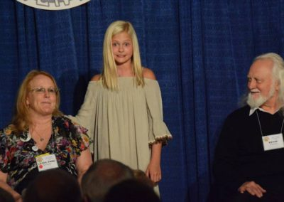 Darci Lynne with volunteers Leigh Anne Huckaby and Kevin Driscoll