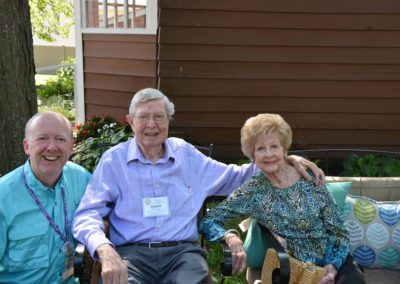 David Crone, Jimmy Nelson, and Betty Nelson enjoy the patio at Vent Haven Museum