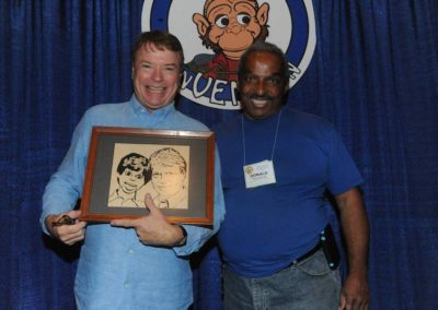 Donald Woodford presents Jay Johnson with a custom wood carving