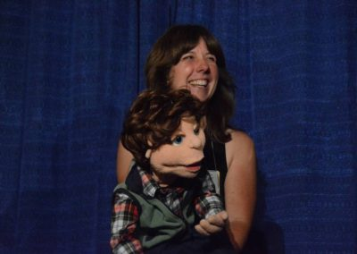 Melissa Taylor with Raffle prize, a MAT puppet