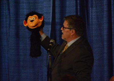 Al Getler shows Chuck Lyons' Lovik monkey that was featured in the 70s Maher catalog