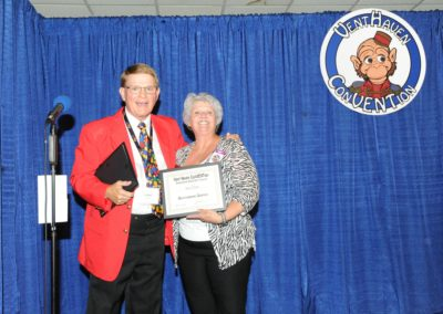 Mark Wade gives Sue Cline a special recognition award for her many years of service to the convention