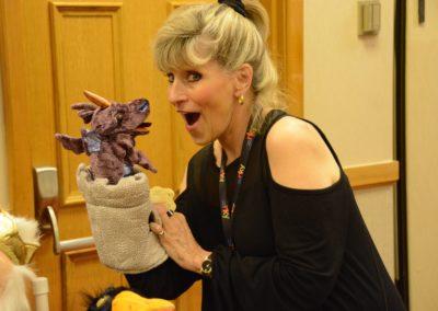 Nina Dees and a cute dragon puppet